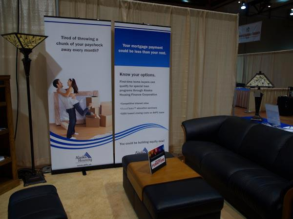 Large format banners with stands at an expo - makes a great backdrop for your booth set up