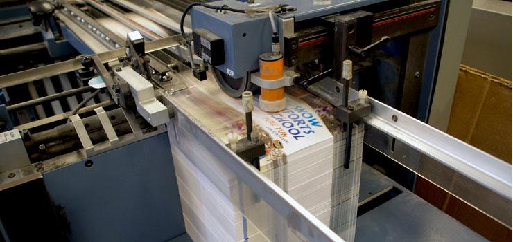 Brochures in the folder, being finished at Alaska Litho's Juneau print shop