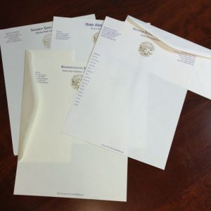 Letterhead samples with State of Alaska gold seal for legislature in varying styles