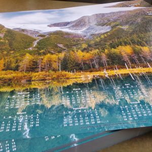 2017 Alaska Litho poster calendars stacked up on the front counter