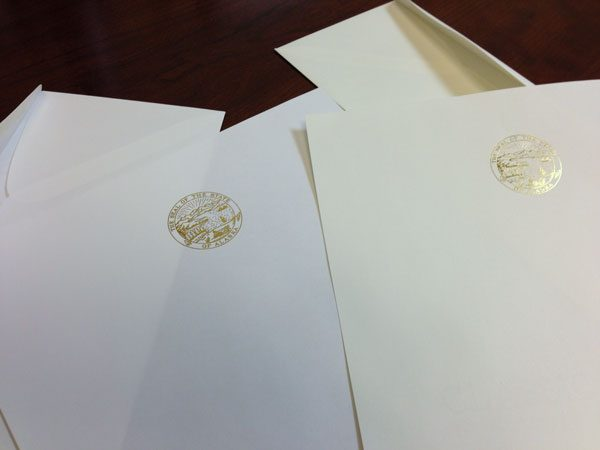 Letterhead in ivory or white with State of Alaska gold seal, matching envelopes