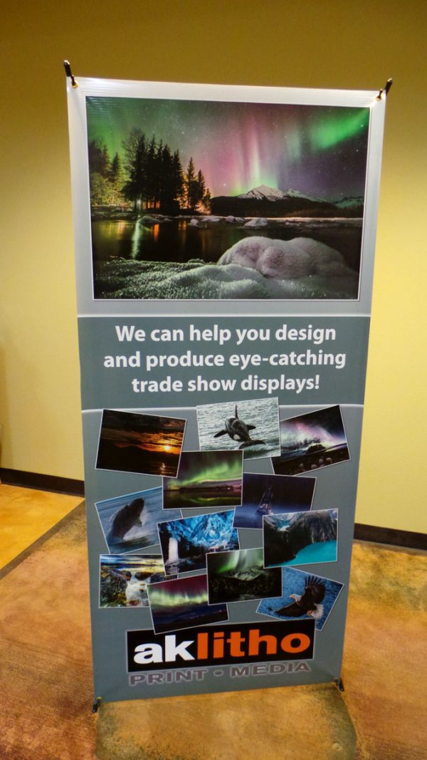 Create a custom banner approximately 32.5 x 72″ to display your message.